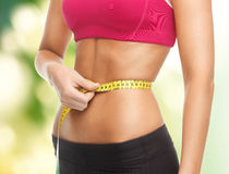 Trained belly with measuring tape Royalty Free Stock Photography