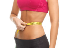 Trained belly with measuring tape Royalty Free Stock Image