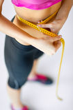 Trained belly with measuring tape Royalty Free Stock Photos