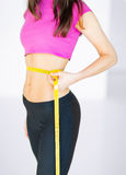 Trained belly with measuring tape Royalty Free Stock Photo