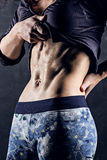 Trained female body close-up, abdominal muscles Royalty Free Stock Image