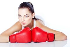 Trained girl playing box in red gloves. Beautiful girl playing box in red gloves and white top Royalty Free Stock Photography