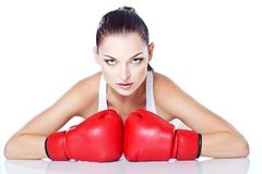 Trained girl playing box in red gloves. Beautiful girl playing box in red gloves and white top Royalty Free Stock Photo