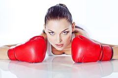 Trained girl playing box in red gloves. Beautiful girl playing box in red gloves and white top Stock Images