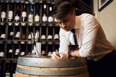 Trained and knowledgeable wine professional. Leaning on the table and working at bar. close up photo stock photo