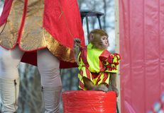 The performance of the trained monkey. A trained monkey performs various stunts before the audience Stock Image