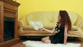 Trained Pigeon. Beautiful girl in evening dress sitting on the floor and in her hand a dove stock video