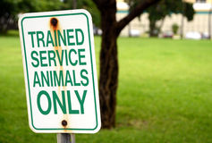 Trained service animals only sign at park in summer Stock Photo