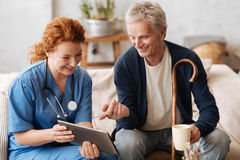 Trained wise doctor entertaining her patient Stock Image