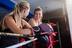 Trainee and coach interacting with each other. In boxing ring Stock Image