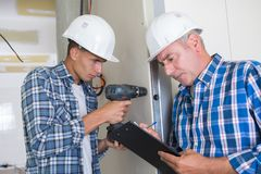Trainee electrician learning their trade royalty free stock image
