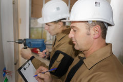 Trainee electrician learning trade royalty free stock image