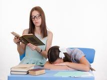 Trainee fell asleep on a boring lesson Stock Photos