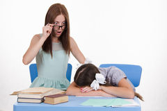 Trainee fell asleep in front of the teacher Stock Images