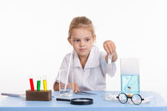 Trainee holds a vial with white powder Royalty Free Stock Photo