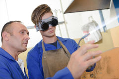 Trainee learning to use blow torch Stock Photos