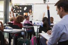 Trainee teacher learning how teach elementary students Royalty Free Stock Photos