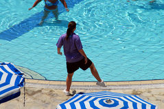 Trainer. Water aerobics trainer showing the exercise Stock Photos