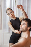Trainer Assisting Ballet Dancer In Rehearsal Room Royalty Free Stock Photo
