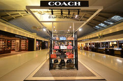 TRAINER boutiqie an Suvarnabhumi-Flughafen Stockbilder
