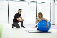 Trainer is checking his client Stock Photography