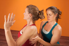 Trainer Checks Shoulder Blade Stock Images