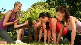 Trainer cheering on group of friends. Slow motion of trainer cheering on group of friends at the park stock footage