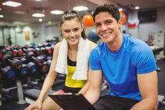 Trainer and client discussing her progress. At the gym Stock Photography