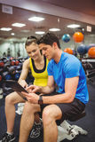 Trainer and client discussing her progress. At the gym Royalty Free Stock Image