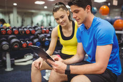 Trainer and client discussing her progress. At the gym Stock Images