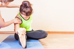 Trainer conducts classes of individual yoga indoor. At yoga class. Concept of a healthy lifestyle and the right attitude to life stock photography