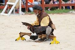 Trainer demonstrates hawks abilitiesenai Stock Photos