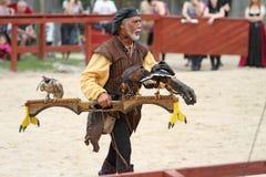 Trainer demonstrates hawks abilitiesenai Stock Image