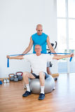 Trainer examining his patient back Royalty Free Stock Photos