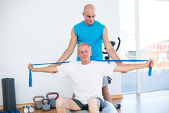 Trainer examining his patient back Royalty Free Stock Photo