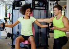 Trainer explaining how to use training machine Stock Images