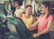 Trainer explaining how to use treadmill Royalty Free Stock Photos