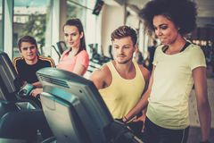 Trainer explaining how to use treadmill Stock Image