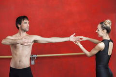 Trainer With Female Ballet Dancer Practicing In Studio Stock Photography