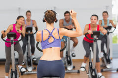 Trainer and fitness class at spinning class Royalty Free Stock Photography