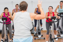 Trainer and fitness class at spinning class Royalty Free Stock Photo
