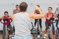Trainer and fitness class at spinning class Stock Photos