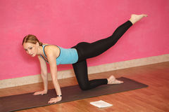 Trainer of fitness or yoga class, woman doing exercise Stock Images