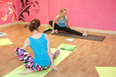 Trainer of fitness or yoga class, woman doing exercise Stock Photography
