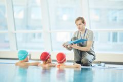 Trainer with flipper. Swim trainer with flipper showing it to his students at lesson of swimming royalty free stock images
