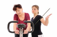Trainer forcing to exercise Stock Photos