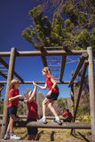 Trainer and girl giving high five to each other during obstacle course training Stock Photos
