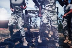 Trainer giving training to military soldiers. At boot camp stock photo