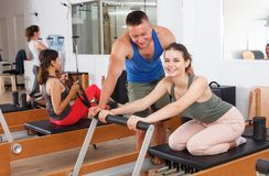 People in the gym with modern fitness equipment stock photo