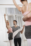 Trainer Helping Ballerina At Dance Studio Royalty Free Stock Images